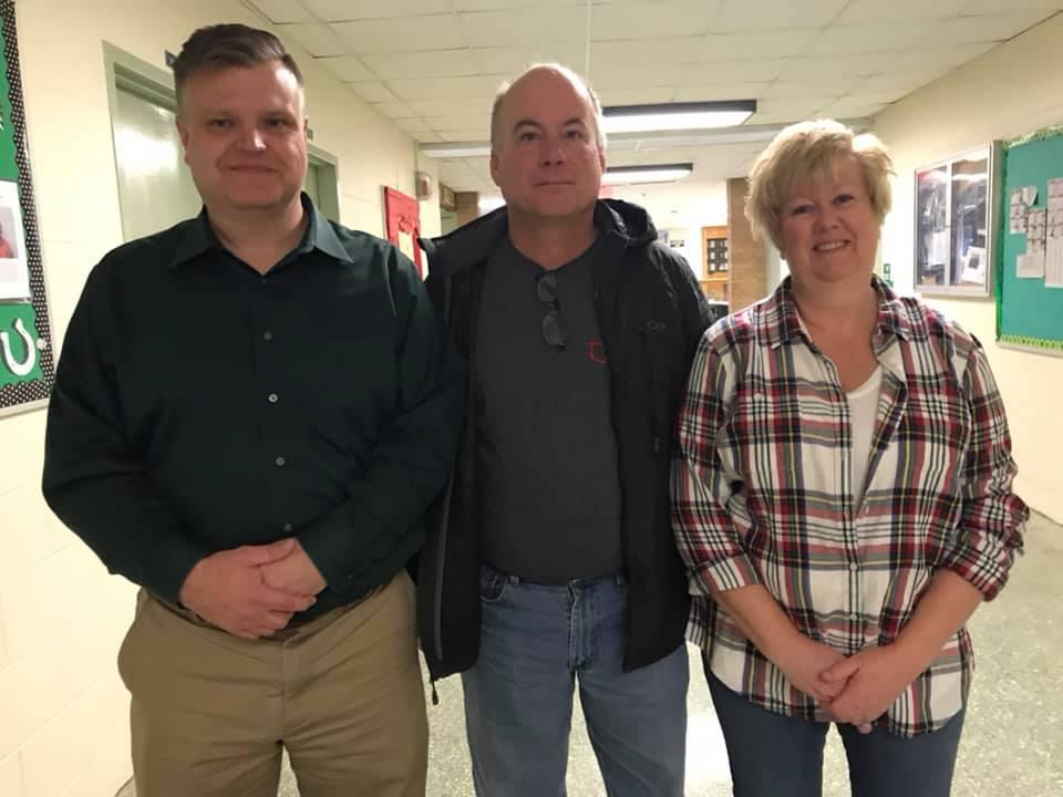 From left: Coach Cameron Flint, Brian Geig, Lynn Geig