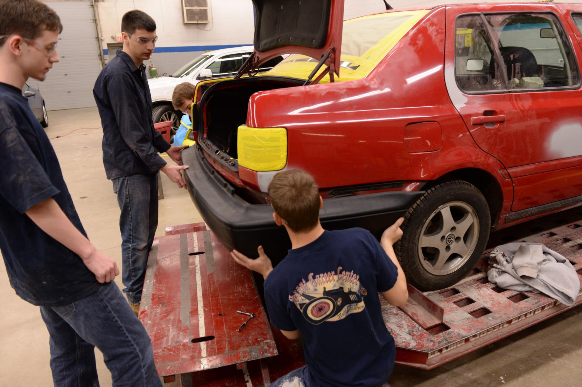 A picture of students installing a bumper