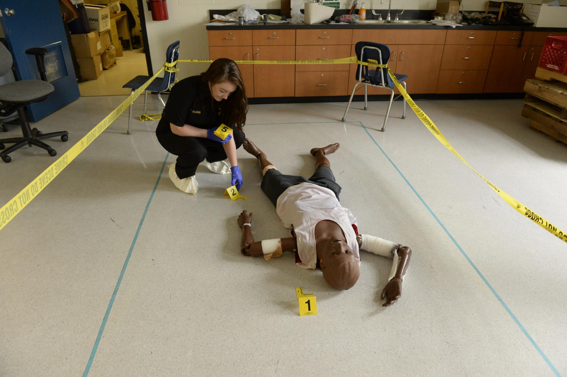 A picture of a student investigating a crime scene
