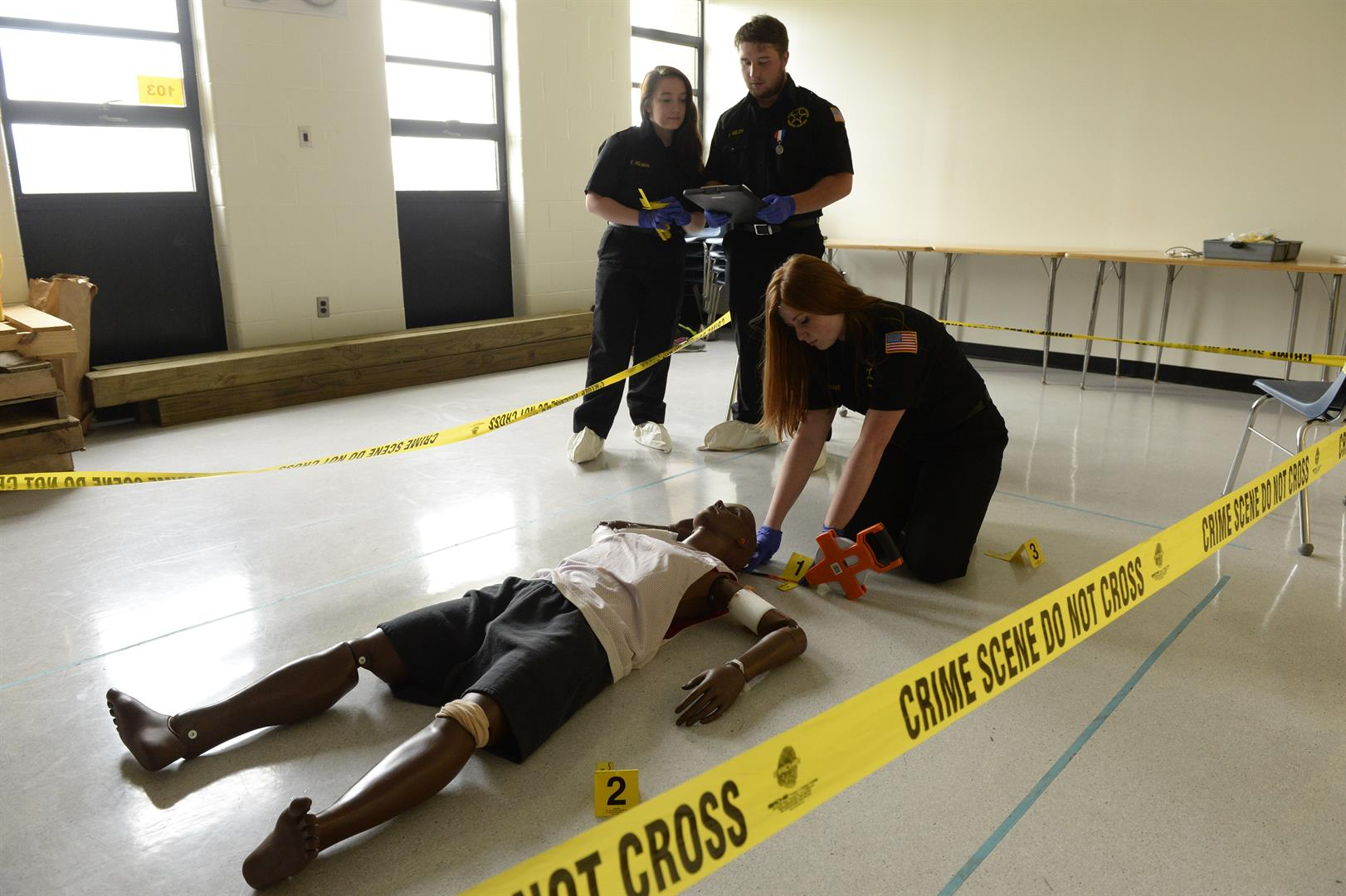 Students practice on a mock crime scene.