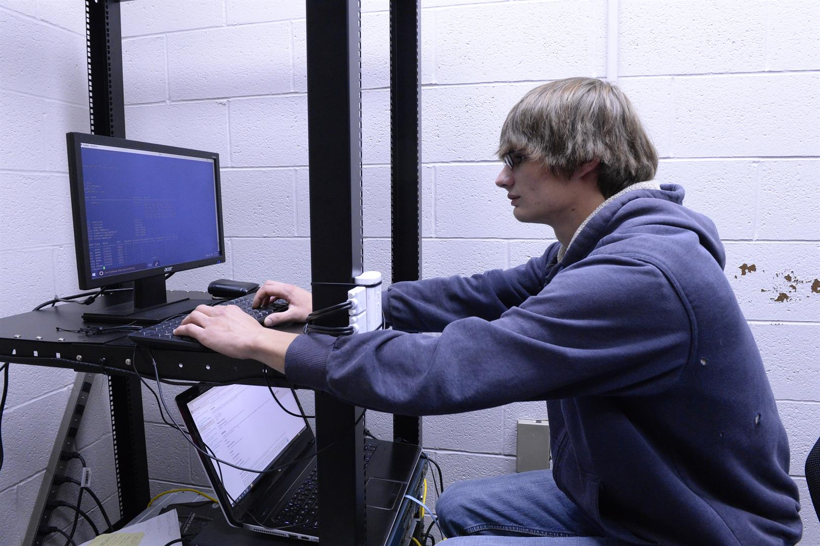 A student works on a server.