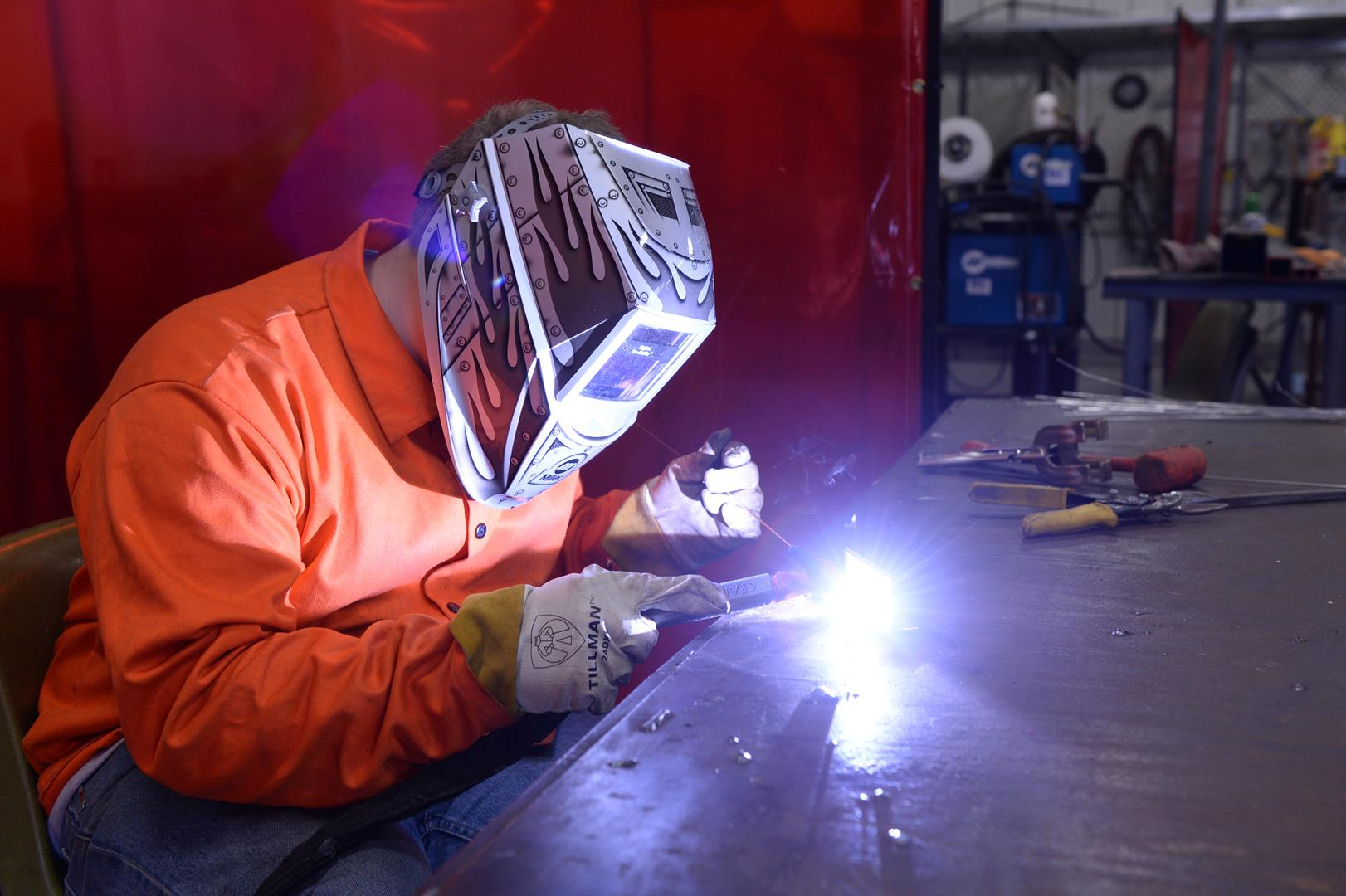A student welds a thin metal rod