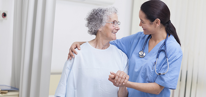 A nurse helps an elderly patient.