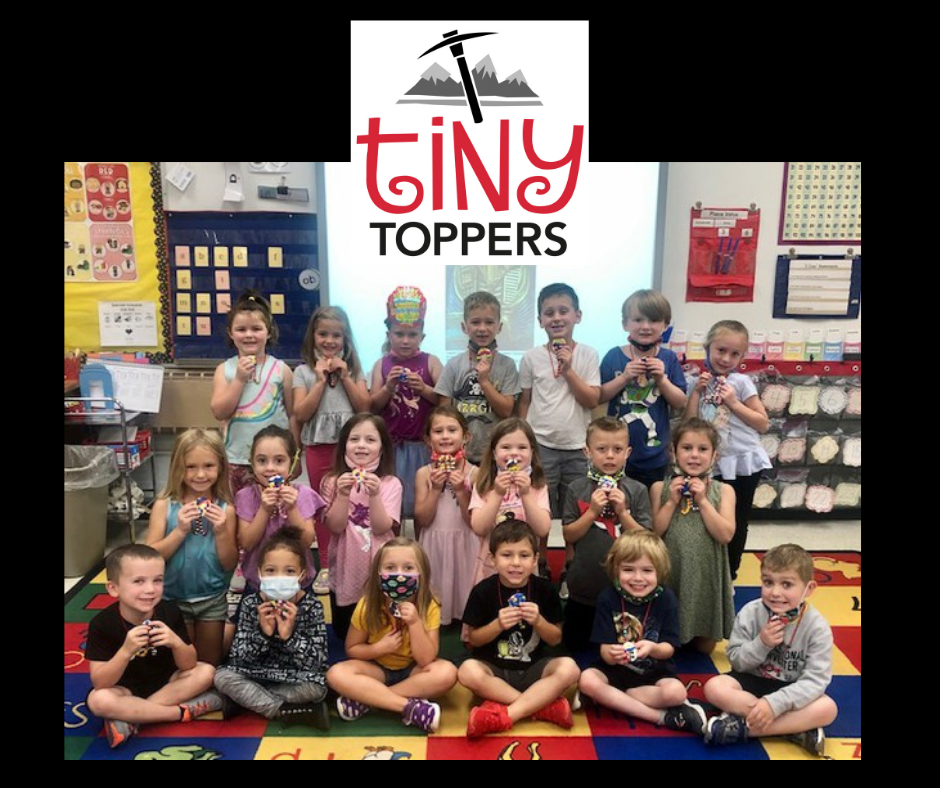 collage graphic featuring Tiny Toppers mountain axe logo (red, black, white); and a group class photo of Kindergarten students at the Chardon Early Learning Center holding up the scarab beetles they made during an Elements of Art class with teacher Mrs. Stickley and student teacher Miss Leake