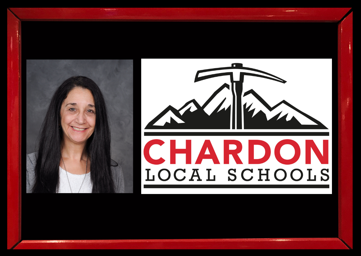 red framed photo of District Treasurer/CFO Mrs. Deb Armbruster (photo credit:  Pastor Photography) and Chardon Local Schools mountain axe logo