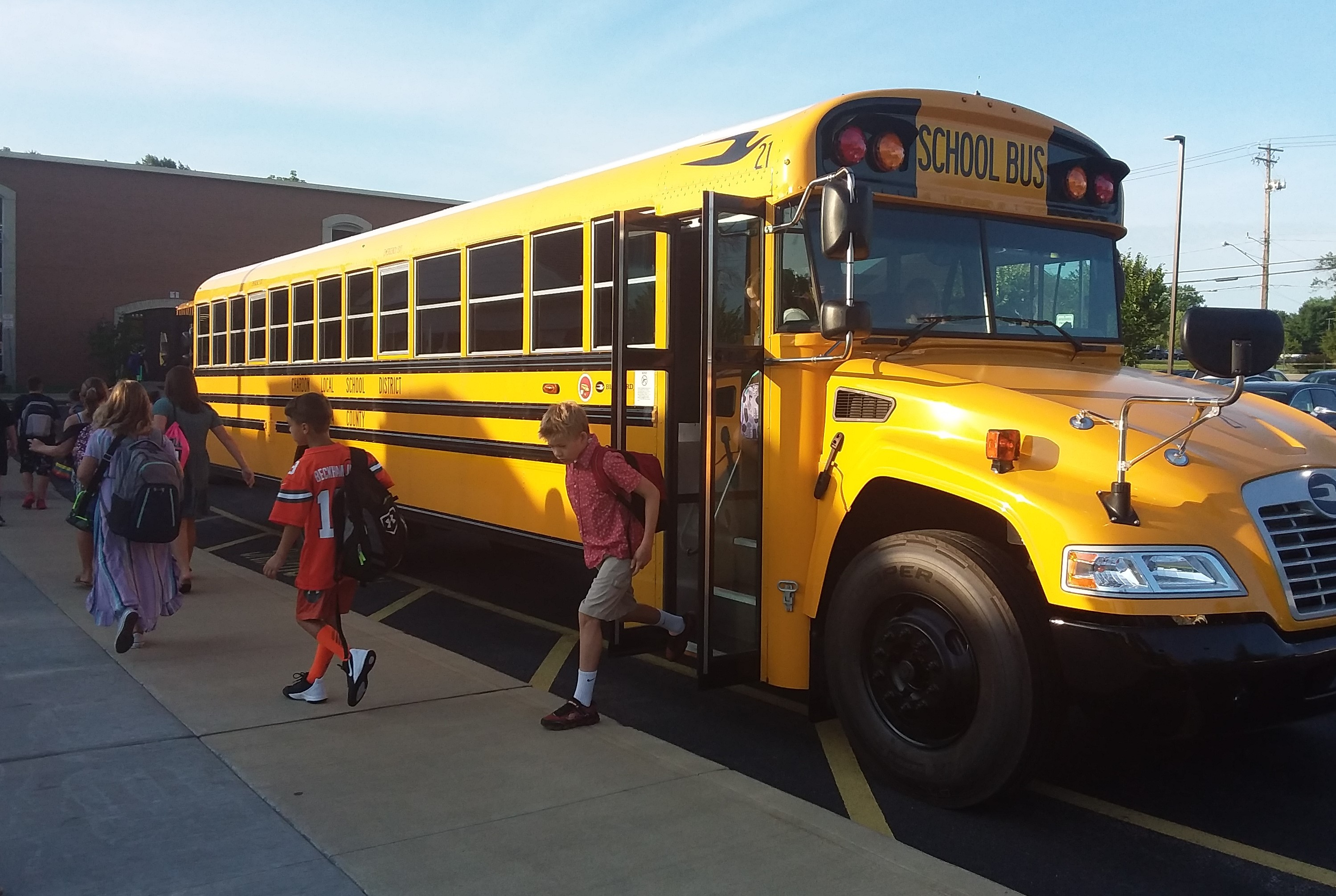 Chardon Schools students exiting school bus at Chardon Middle School