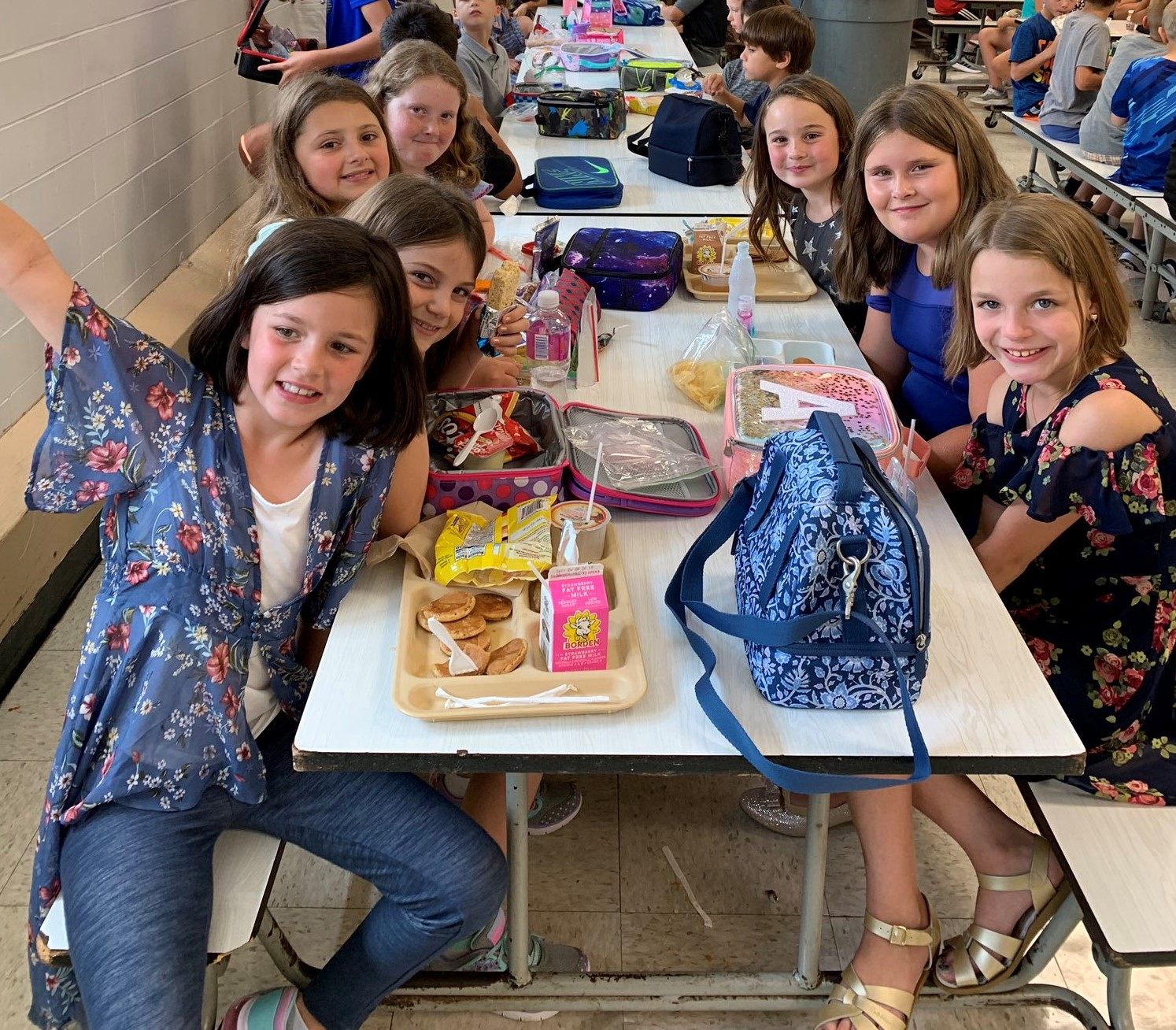 Park Elementary Students at the Lunch Table and smiling - Fall 2019