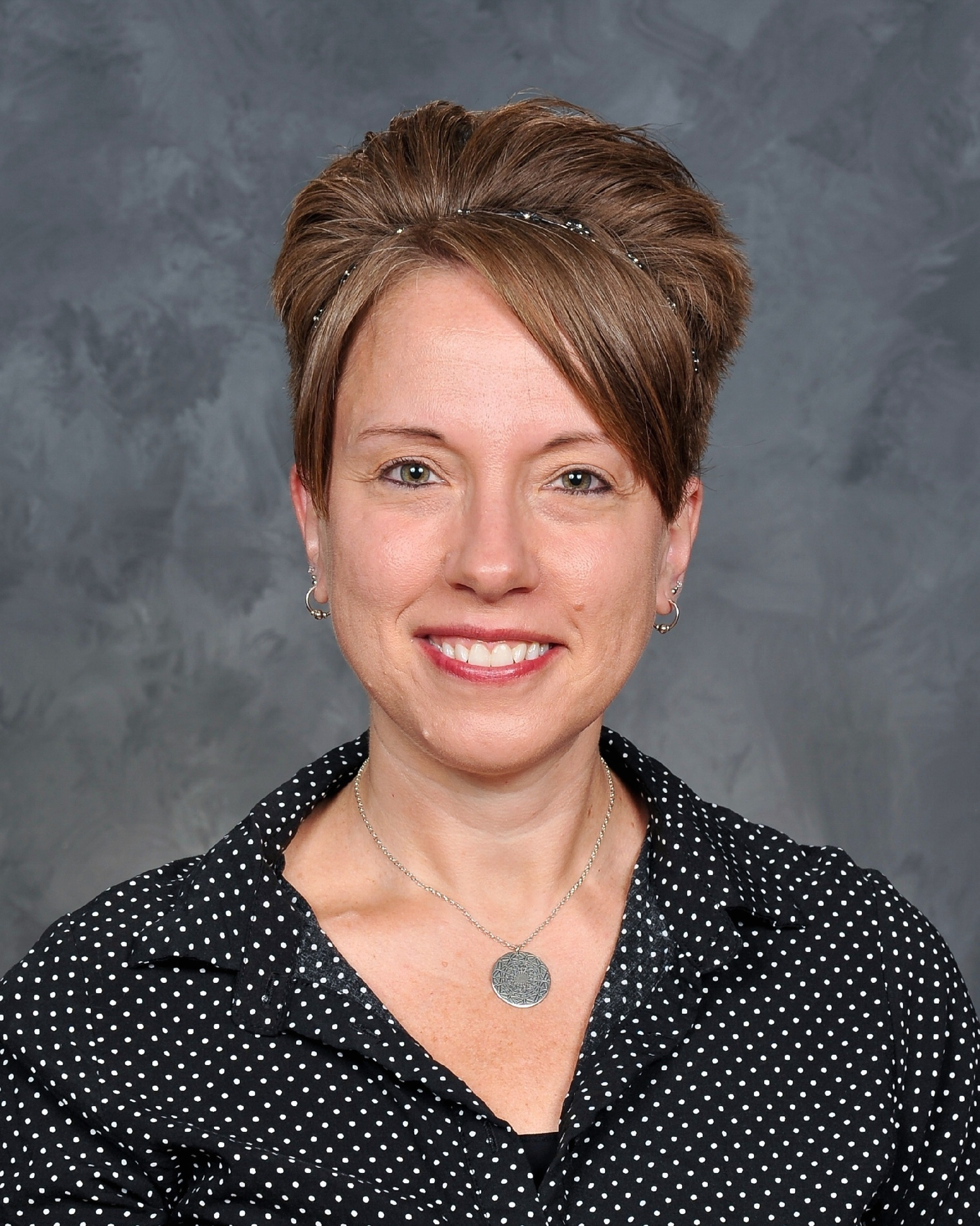staff headshot photo of Kelly Misch, District Communications Director [photo credit:  Pastor Photography]