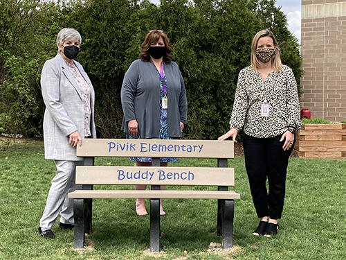 """Mrs. Renee DeMichiei Farrow donated a Buddy Bench to Pivik Elementary students as a way for her family to give back to the community and pass along the lessons she learned battling bouts with bullying. Farrow who openly shares about her experiences being a bully and being on the receiving end of bullying, and said the bench is designed to create healthy social and emotional connections, encourage friendships, increase a sense of belonging, and eliminate loneliness.    A Buddy Bench is a tool to help students to express acts of kindness. Students can choose to sit on the bench to signal they are looking for someone to play with or having a difficult day. When another child sees someone sitting on the bench, they are encouraged to invite them to play.    Mrs. Farrow says, """"Based on recent events, we need to be kinder and more empathetic and help someone who is not having a good day. With my history, this is something I am very passionate about — helping children learn how to be respectful of others.""""  Mrs. Amy Palumbo, Guidance Counselor at Pivik Elementary School, says """"It's been a wonderful experience watching the children use the bench. It fosters friendship and allows for inclusion. Students are still learning how to communicate their feelings. Sitting on the bench helps them to verbalize what they feel when they need a friend."""""""
