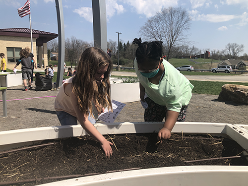 """Spring Garden Day was on April 8th at Center Elementary School. Students had the opportunity to get outside and plant vegetables such as carrots, peas, radishes, beets, lettuce, and spinach, and participate in a Spring Garden Scavenger Hunt!    Students also learned about the life cycle of plants, how to grow fruits and vegetables gives them healthier foods to eat, and how to take care of the environment. Students in grades K-4 also participated and learned where food comes from and the importance of growing a garden.   The students were very excited about the hands-on opportunity to discover the importance of the health of the soil, pulling weeds and other gardening disciplines.               The garden was built with a grant from Grow Pittsburgh in the Fall of 2019, thanks to the efforts of our librarian at the time, Mrs. Pilarski. The Grow Pittsburgh grant helps facilitate lessons with the students to share their knowledge and expertise before passing it on to the school/teachers.  Science teacher, Mr. JR Pilyih said, """"We can't wait to get the garden up and running again. It will bring life back to our outdoor space and the students are going to be so excited to watch everything grow.  Hopefully, we have a great harvest by the end of the school year and we can complete another round of planting for our summer crops! Of course the main objectives of this entire project are for students to make healthier food choices, eliminate food waste, and hopefully even want to have a garden of their own at home!""""  Students will gather again to harvest their crops by the end of the school year.  Check out the latest developments with the Garden here."""