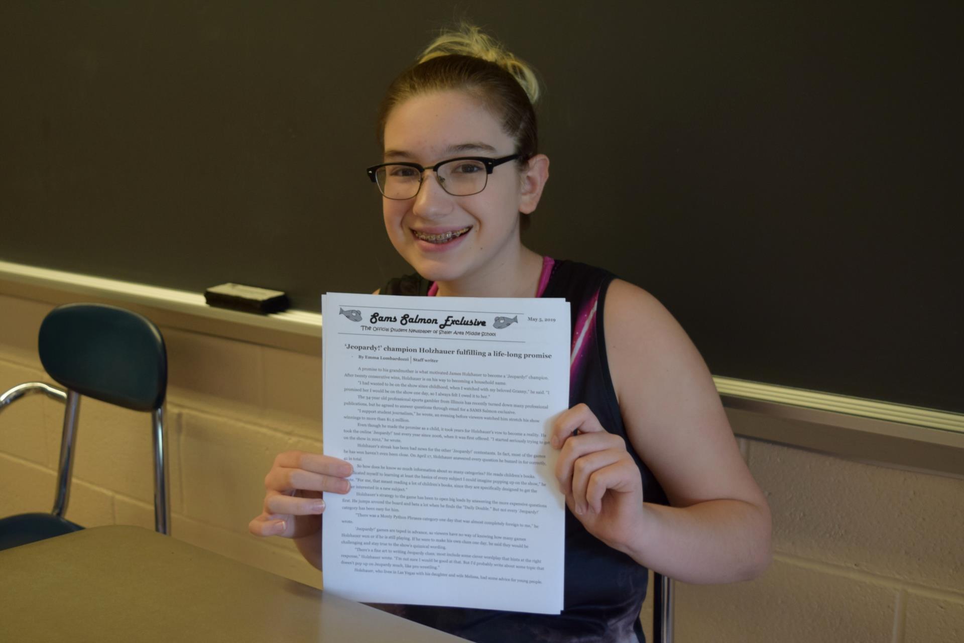 Emma Lombardozzi holding copy of article