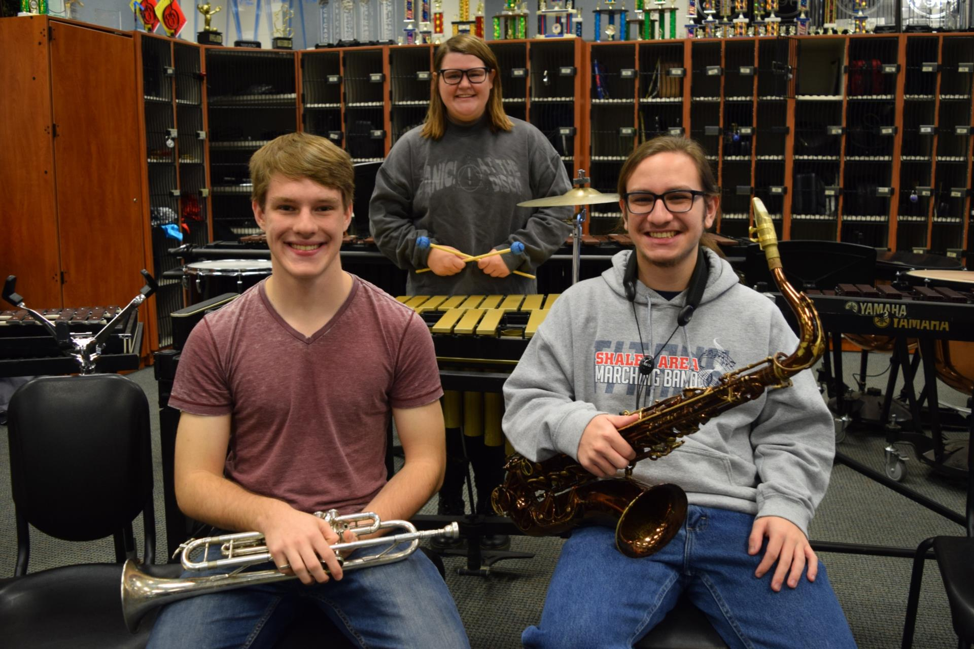 Luke Rachel and Zach in band room with instruments