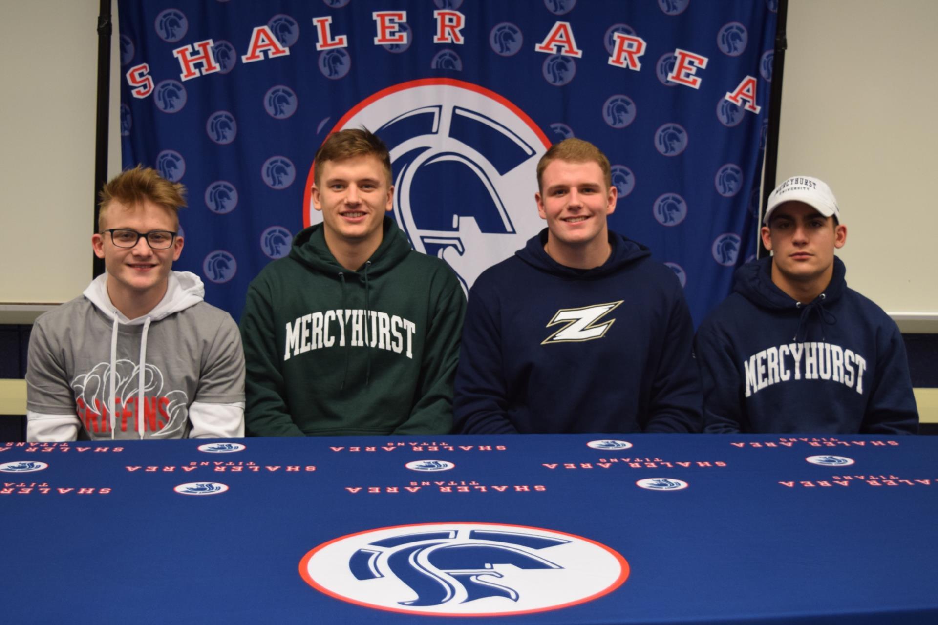 shayn, darin, jake, and joey sitting at table