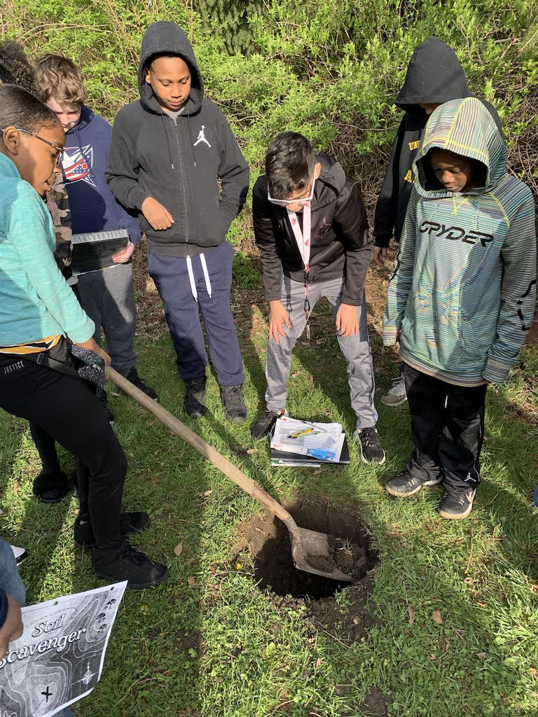 students digging in soil