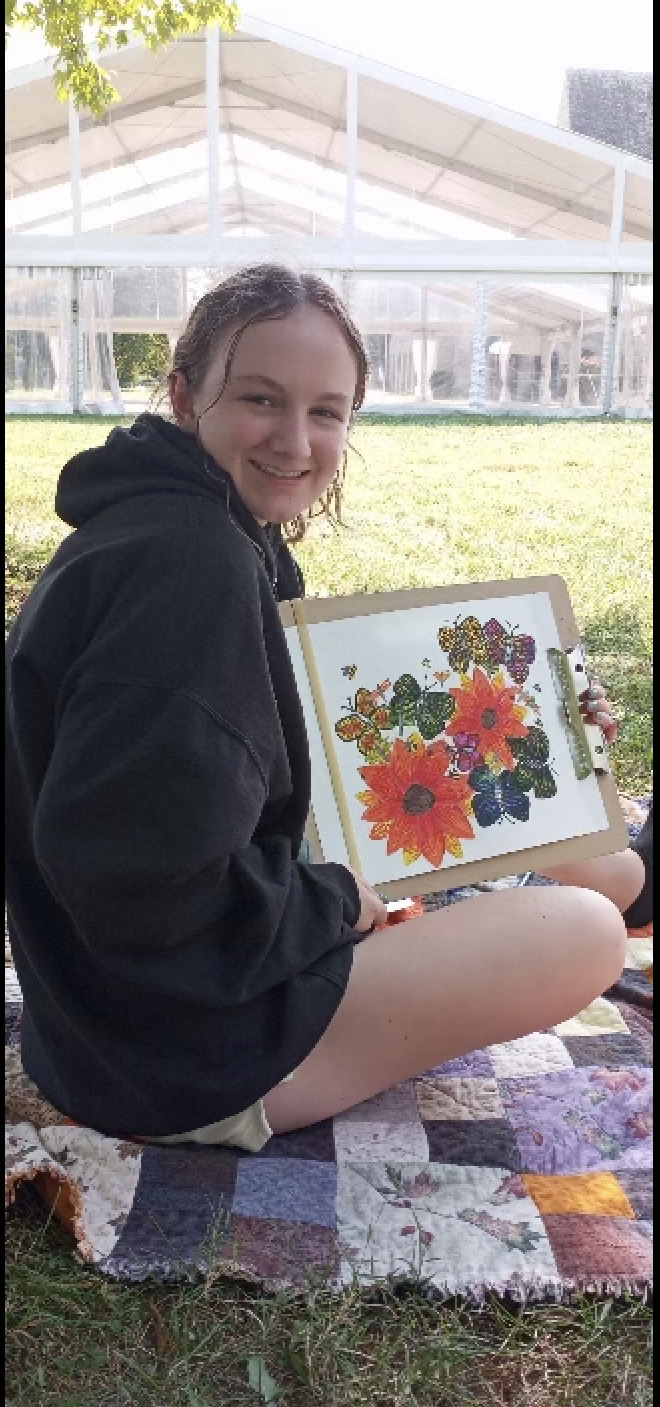 Cailee Gilfillen with one of her pieces of art