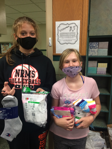 MIddle School students holding socks